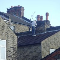 HSE health and safety worker on roof dangerous CDM