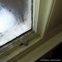 condensation on sash window, building survey in hythe kent