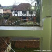 cracked glass in sash window - found on a building survey