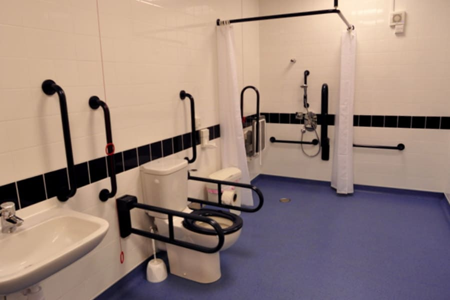 accessible wc and shower room, colour contrast, grab rails