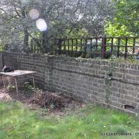 broken rat run garden wall, party fence wall, blackheath, london