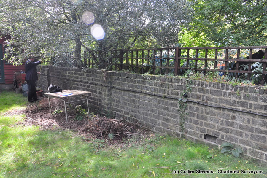broken rat run garden wall; party fence wall; blackheath; london