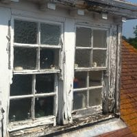 defective and broken sash window in need of repair, timber decay
