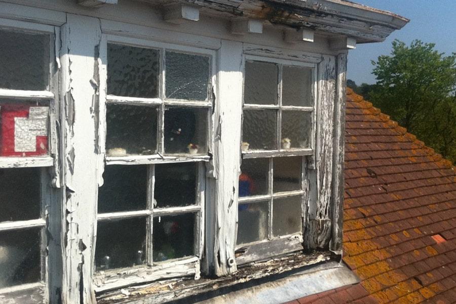 defective and broken sash window in need of repair, timber decay